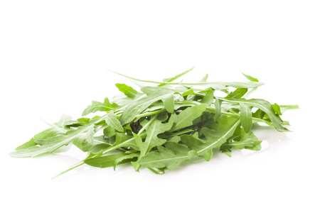 Fresh green arugula heap isolated on white Stock Photo - 16876563
