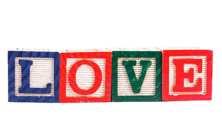 Word love made from alphabet blocks on white photo
