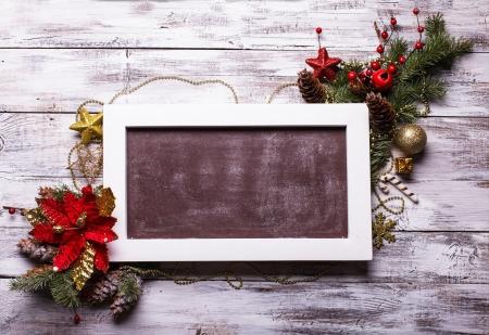 Navidad tablero de diseño con flor de pascua para los saludos