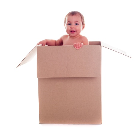 conform: A small child (baby) crawls out of the box isolated
