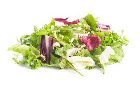 Heap of green healthy leaves salad on white photo