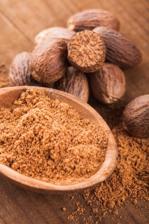 Ground nutmeg spice in the wooden spoon closeup Stock Photo - 17580996