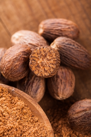 Ground nutmeg spice in the wooden spoon closeup Stock Photo - 17580993