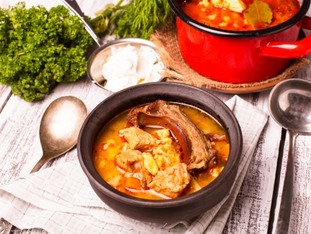 caldron: Traditional hungarian dish - bogracs goulash, stewed meat and vegetables in cauldron