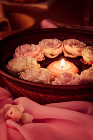 Spa relaxation - burned candle floating in rose water Stock Photo - 17708669