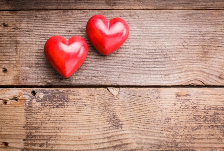Two red hearts on old shabby wooden background with copy space Stock Photo - 17708706