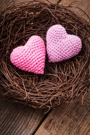 incubate: Little cozy nest with two crochet hearts. Valentines day decorations