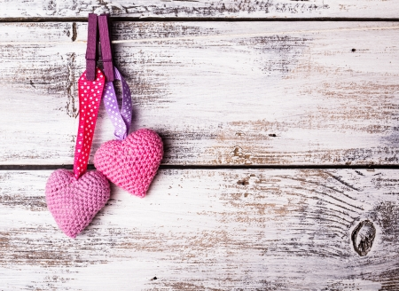 chic: Crochet valentine hearts handing on the rope. Valentines day greeting card. Love concept Stock Photo