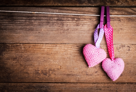 Crochet valentine hearts handing on the rope. Valentines day greeting card. Love concept Stock Photo