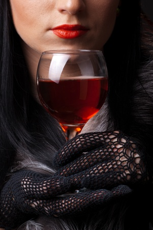 Red lips and glass of wine close up photo