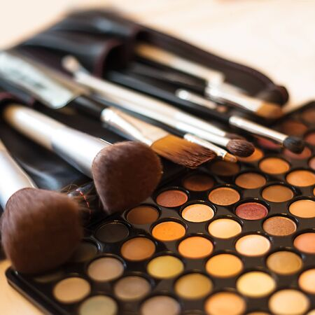 Eye shadow palette in natural colours and make up brushes Stock Photo - 18049376