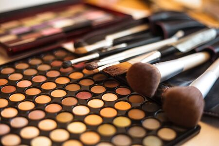 make up brushes: Eye shadow palette in natural colours and make up brushes Stock Photo