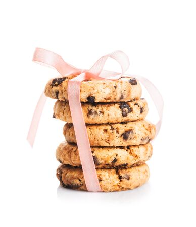 Crunchy cookies with chocolate drops isolated on white photo