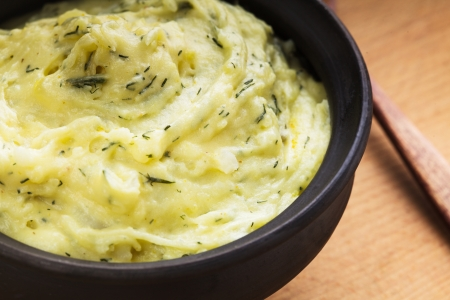 mashed potatoes: Mashed potato with dill in organic clay bowl