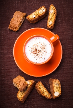 Cantuccini - typical almond cookies with cappuccino cup photo