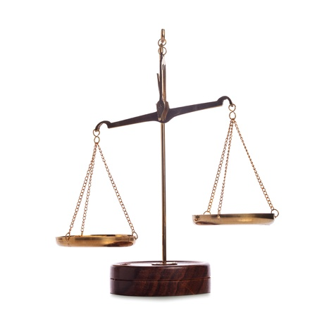 scales of justice: Unbalanced golden vintage scales isolated on white