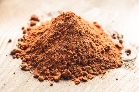 chocolate powder heap over wooden background Stock Photo - 18647149