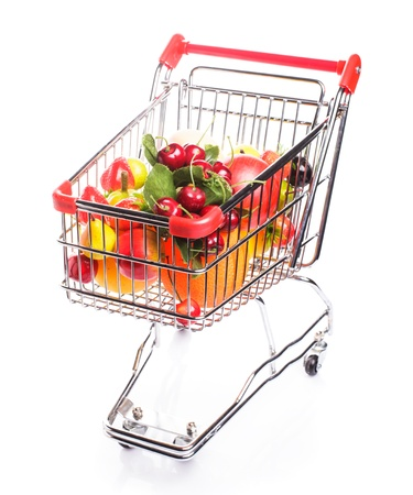 Shopping trolley with fruits isolated on white photo