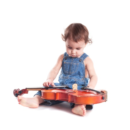 baby and violin isolated on white. Choosing future profession photo