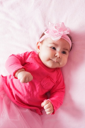 Three month old baby girl in pink tutu photo