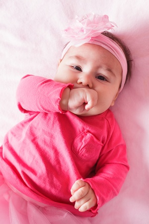 chew over: Three month old baby girl is sucking her fist