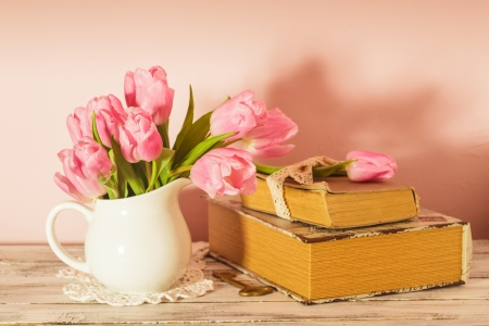 Memo still life with books, key and pink tulips