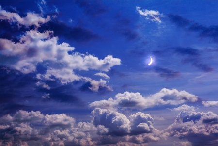 Moon on the sky with curly clouds photo
