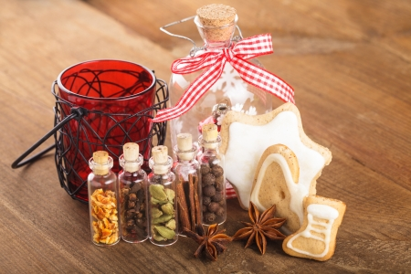 Christmas spices for mulled wine or ginger cookies in small decorative bottles photo
