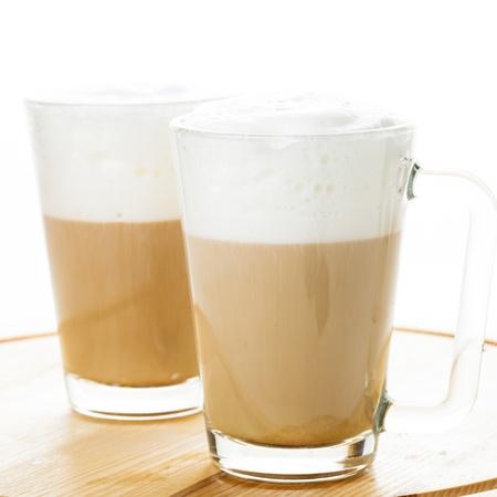 Coffee latte in glass mugs on the board photo