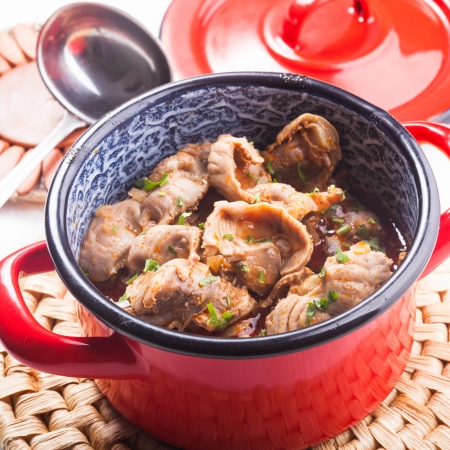 chitterlings: Stewed chicken gizzards in red pan on the mat