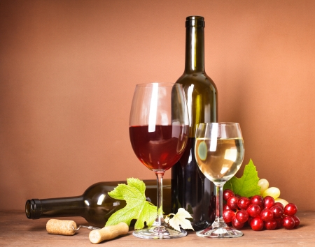 Wine still life: bottles, corks, grapes and glasses Stock Photo