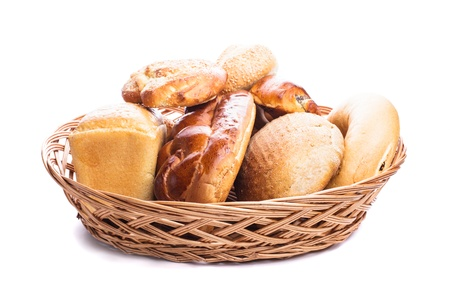 Different types of breads and buns in the basket on a white photo