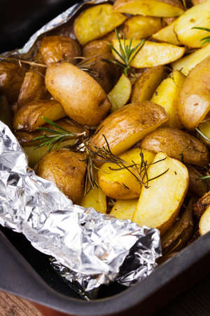 Rusic style potato  with rosemary baked in foil photo