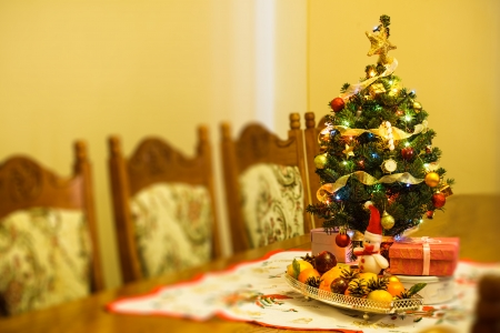 small christmas tree with decorations gifts and citrus on the table stock photo 22360294 - Small Christmas Decorations