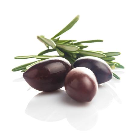 Olives calamata with leaves isolated on white photo