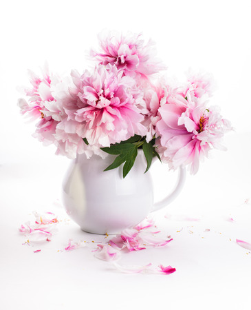 vase of flowers: Pink peonies in vase isolated on white