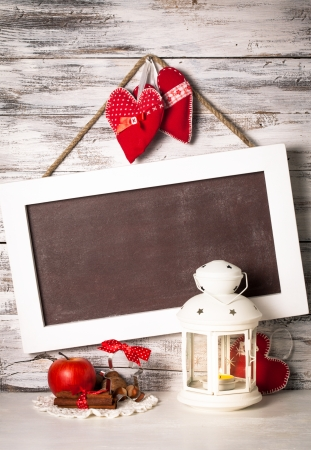 Cristmas lantern with board for greetings over shabby wooden wall photo