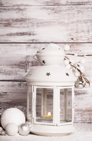 Cristmas lantern with decorations and snow over white shabby wooden background Stock Photo - 22360387