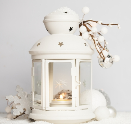 Cristmas lantern with decorations and snow over white  background photo