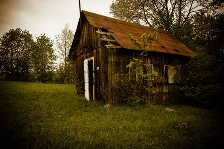Old abandones lonely house near the forest photo