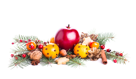 Christmas sweet decor - fir, tangerins, apple and spices. photo