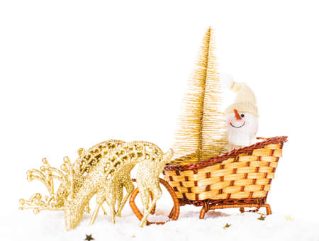 Christmas snowman with gold tree on the sledge photo