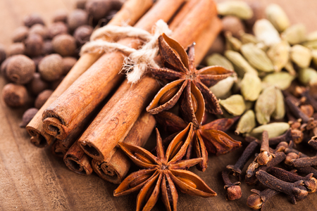 aniseed: Collection of spices for mulled wine and pastry on the wooden table Stock Photo