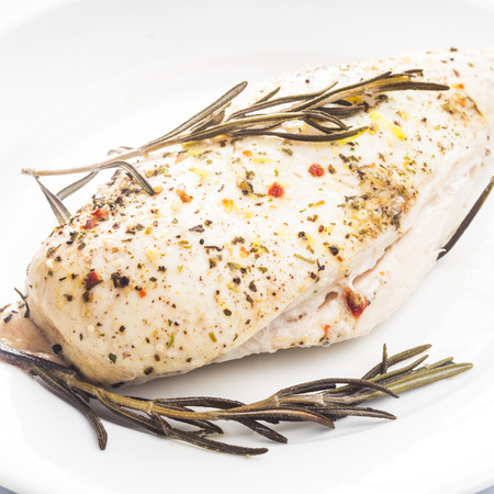 roasted chicken fillet on a white plate photo