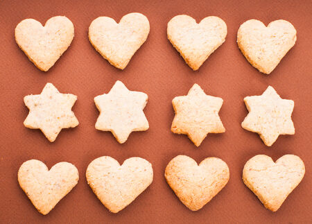 shortbread: Holiday cookies as a background pattern on brown