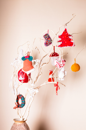 Christmas handmade decor on the branches over wall photo