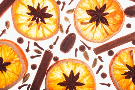 Christmas background with spices and dry orange's slices photo