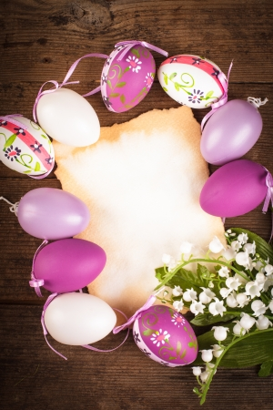 Purple and white eggs and empty greeting card. Easter decorations photo