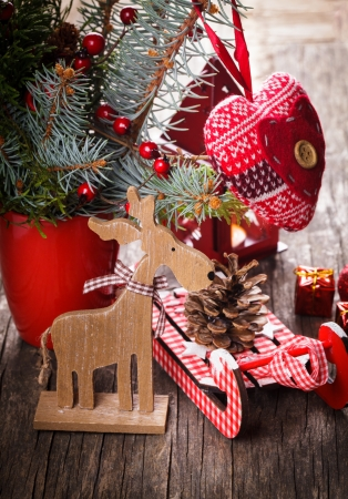 deer in heart: Christmas decorations: heart, deer and sleds on old wooden table