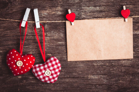 Two hearts and craft envelope  attached to the rope. Valentine greetings photo